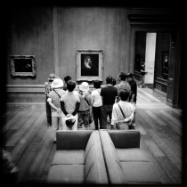 Japanese Tourists Looking at Art